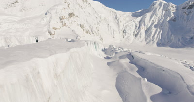 Very Low,POV Aerial Over Deep Chunky Snow,Crevices,Possibly Glacier