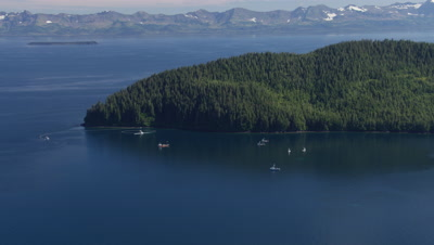 Aerial Alaska,Boats off shore of forested island