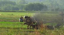 Tractor In China Belching Smoke While Person Smokes Cigarette Industrialization