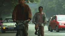 China Chinese Rickshaw Riding Bicycle On Busy City Street Industrialization Auto Industry China