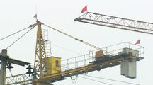 China Chinese Cranes With Red Flags Tilt Down To Construction Workers Rapid Development Building Boom
