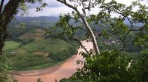 China Chinese Forest Tilt Up To Reveal Brown River In Chinese Countryside