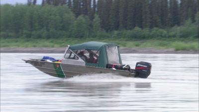 Aluminum Boat Speeds Upriver On Yukon River Motor Boat Alaska