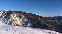Aerial forward looking Alaska Brooks Range ragged snow covered mountains Gates of the Arctic Alaska Dramatic Scenery