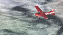 Alaska bush plane flying over glaciers and rugged mountains, alaska transportation remote
