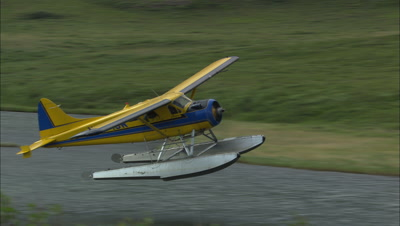 Dehavillan Beaver Floatplane Taking Off From Arctic Lake Bush Plane Alaska Transportation Toursim Ecotourism