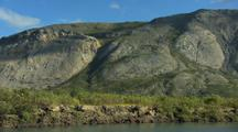 Pan Across Scenic Mountain And Bluffs By Yukon River