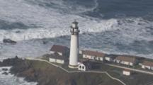 Aerial Shot Of Lighthouse Pigeon Point Ocean Swell Waves Crash Against Beach In Background