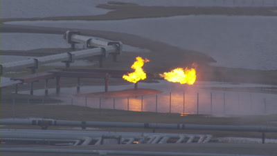 Aerial Cineflex Shot Of Prudhoe Bay Natural Gas Flares At Oil Production Facilities Burnoff, Pull To Wider Shot