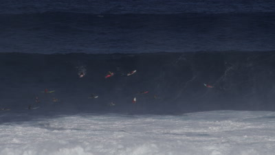 Jaws - big wave surfing- lineup with surfers paddling-wipeout