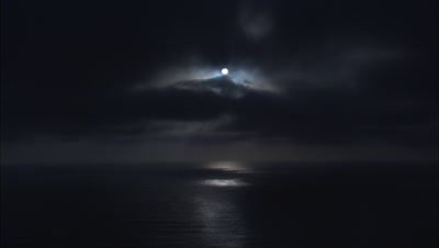 Moon Setting, Reflects On Calm Pacific Ocean