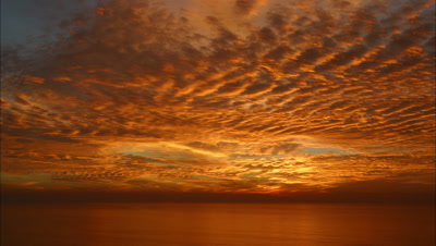 Dramatic Clouds Move Across Sky At Sunset