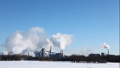 4K UltraHD A timelapse view of smoky pollutants pouring from a refinery