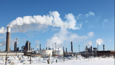 4K UltraHD Timelapse view of smoky pollutants pouring from a refinery