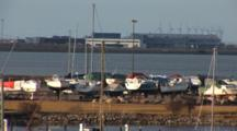 Slow Pan Of DragøR Marina Dry Boat Storage With Wind Turbines In The Background