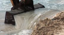 An Excavator Scoops Sand From The Sea Floor, Close Up