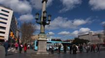 Hand Held Shot On A Busy Street In Barcelona Spain, The Alain Afflelou Plaza CataluñA