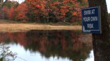 Maine Scenic In Fall Colors - Shot Pans Accross Stream To A Warning Sign