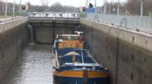 A Cargo Ship In A Dutch Lock, Master Releasing The Lines