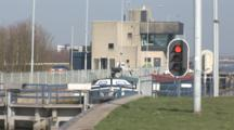 A Cargo Ship In A Dutch Lock, Still Life Of Ship And Traffic Light