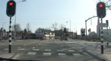An Intersection After A Commuter Train In Holland Passes Through, Wide Shot