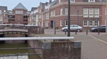A Small Dutch Town And Waterway.  Shot Pans Left.