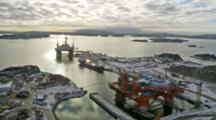 Aerials Over Northern European Cities In Nordic Countries, Oil Rigs And Oil Production