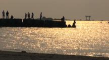 Hayama, Japan - Fisherman On Jetty In Shimmering Light, Jet Ski And Person Go By