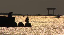 Hayama, Japan - Fisherman On Jetty In Shimmering Light, Windsurfer Sails By