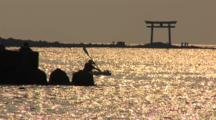 Hayama, Japan - Fisherman On Jetty In Shimmering Light, Sea Kayak Goes By