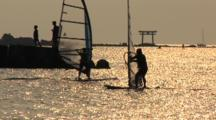 Hayama, Japan - Fisherman On Jetty In Shimmering Light, Windsurfers Sails By