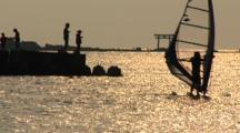 Hayama, Japan - Fisherman On Jetty In Shimmering Light, Windsurfers Go By