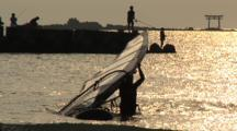 Miyake Jima, Japan - Wind Surfer Walks Board By In Shimmering Light On Water
