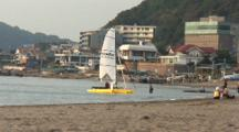 Hayama, Japan - Sailing Boat Getting Rigged Near Beach