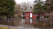 Major Flooding In A Small New England Town, House Stands In The Middle Of A River