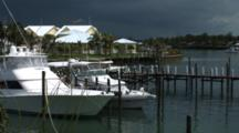 Sportfishing Boat In A Slip In A Bahamian Marina, Pan To The Left
