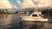 Sportfishing Boat Leaving Dock, Soft Early Morning Light, Pan To Left