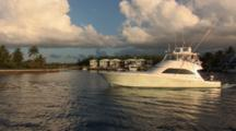 Sportfishing Boat Underway In Marina, Soft Early Morning Light, Shot Pans Left While Zoomnig In
