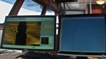 Side Scan Sonar - Close Up Of Two Computer Display Showing An Image Of A Shipwreck On The Bottom