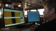 Side Scan Sonar Operator Points Out Acoustic Returns On Computer Displays