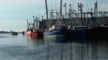 Group Of Commercial Fishing Boats Sitting Idle In Port