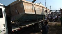 Old Boat Being Loaded Onto A Flat Bed Truck For Disposal