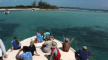 Eco-Tour Guests On Bow Of Boat, Approach A Calm Tropical Cove