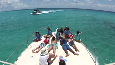 Passengers On Bow Of Boat Searching For Atlantic Spotted Dolphins (Stenella Frontallis) In Bahamian Water And Bahamian Navy Boat Cruises By
