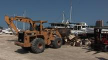 Heavy Construction Equipment Cleans Up The Remnants Of A Destroyed Boat