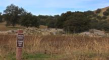Shot Pans Accross Oak Woodland Landscape, Ends On An Environmental Sign, Speces:  Blue Oak (Quecus Douglasii)