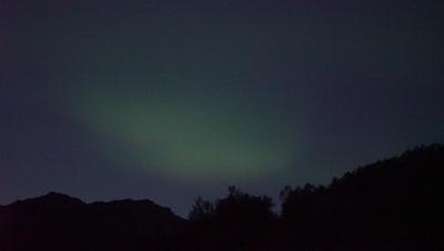 4K Northern Lights in summer sky above mountains Aurora Borealis - NO Colour Correction