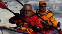 Kayakers Maneuver Around Floating Ice In Antarctic