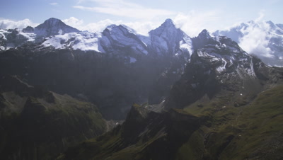 Wide static shot of Swiss Alps and clouds.