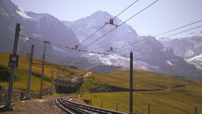 Swiss railway in front of Alps in Grindelwald, Switzerland